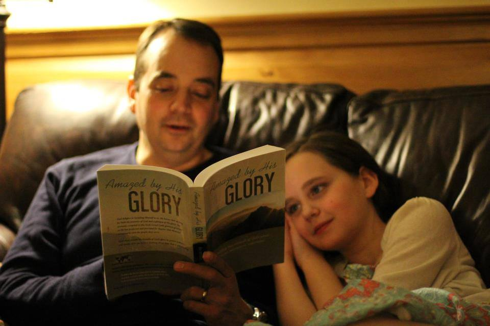 I love this pic because it's a common one. Daddy sitting by the light reading and the kids snuggling in to hear him. Melt!