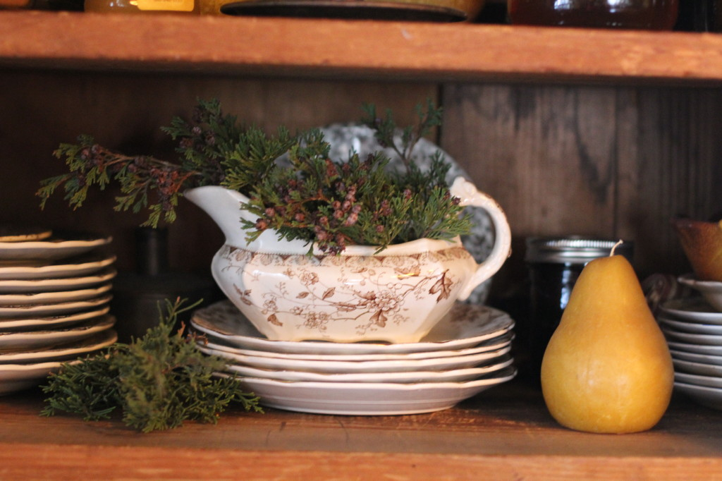 I stick cedar and holly everywhere. My grandmother gave me this brown transfer-ware gravy boat and dish set.
