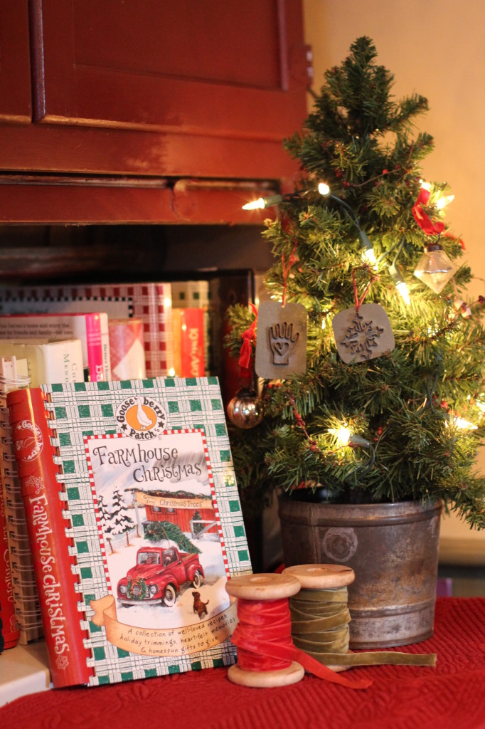 Kitchen tree with antique style mini cookie cutters. My hoosier holds all of my Gooseberry Patch cookbooks.